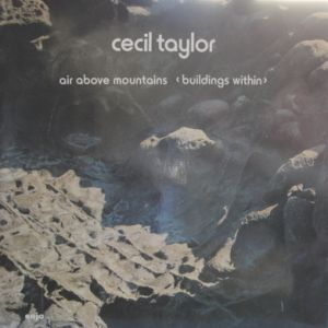 TAYLOR CECIL air above mountains buildings within
